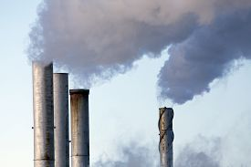 stock photo of polluted  - Pollution discharge industry in Canada pipes spewing smoke - JPG