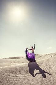 picture of barchan  - Woman in violet skirt dancing in the desert - JPG