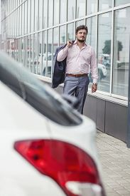 foto of going out business sale  - Businessman man goes to the car in the urban district - JPG