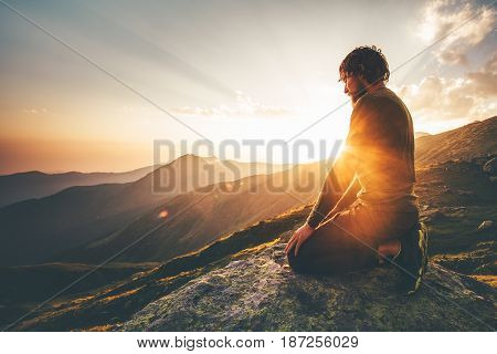 poster of Man relaxing at sunset mountains Travel Lifestyle spiritual awakening emotional meditating concept vacations outdoor harmony with nature landscape