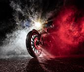 High power motorcycle chopper at night. Smoke on background. poster
