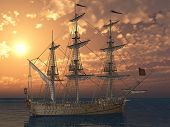 ship with sails in sunset light