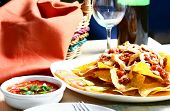 nachos with beef and spicy salsa poster