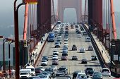 Zoom of heavy traffic on Golden Gate Bridge, connecting San Francisco to Marin County, warm air risi