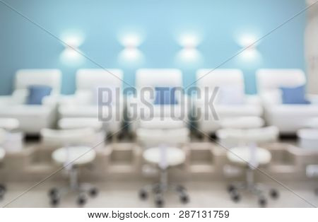 poster of Nail Salon Interior As Creative Abstract Blur Background. Pedicure Armchairs In A Modern Salon. Insi