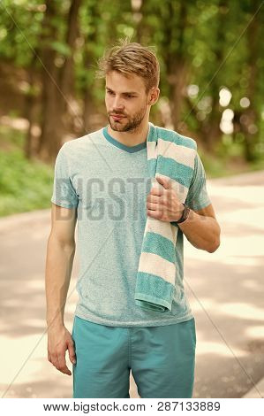 poster of Tired Man. Tired Man With Towel Relax After Training In Forest. Man Tired After Running In Park. Man