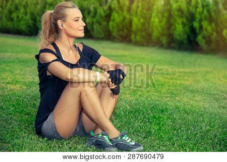 Female exercising outdoors pretty blond
