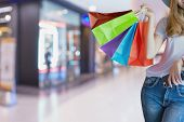Asian Woman Shopping Holding Shopping Bag And Use Of Mobile Phone At Shopping Center. Consumerism, S poster