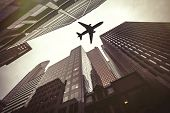 Plane Aircraft Flies At Low Altitude Just Above The Roofs Of Skyscrapers Of A Modern City. Travel Sa poster