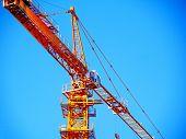 Construction Crane Near The Building Under Construction. Crane. Self-erection Crane. Industrial Back poster
