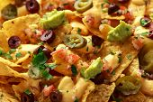 Mexican Nachos Tortilla Chips With Olives, Jalapeno, Guacamole, Tomatoes Salsa And Cheese Dip. Close poster
