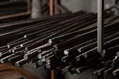 Metal Rods For The Building Of Houses Lie In The Row. Close Up Of Metal Armature Of Different Thickn poster