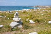 picture of fulcrum  - Cairns and stones at the French coast of Brittany - JPG