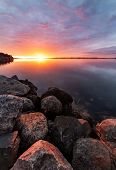 Colorful And Vivid Sunrise Over The Sea A Calm Winter Morning poster