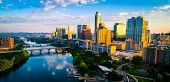 Aerial Drone View Of Austin Texas Skyline At Sunrise Over Lady Bird Lake With Perfect Reflection Off poster