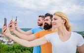 Experiencing Digital Picture Sharing. Best Friends Taking Selfie With Camera Phone. People Shooting  poster