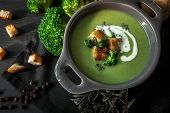 Spring Detox Broccoli Green Cream Soup With Potatoes And Vegan Cream In Bowl On Dark Wooden Board Ov poster