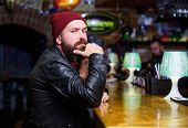 Brutal Hipster Bearded Man Sit At Bar Counter. Friday Evening. Bar Is Relaxing Place To Have Drink A poster