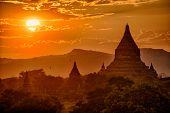 Sun is rising over old pagodas of an ancient city of Bagan, Myanmar poster