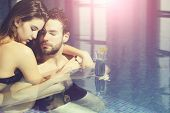 Wet Couple Of Pretty Woman Or Sexy Girl And Handsome Bearded Man Or Guy With Muscular Body In Swimmi poster