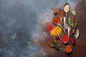 Set of various spices and herbs on stone background. Top view with space for your recipe. Flat lay poster