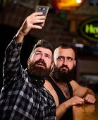 Online Communication. Man Bearded Hipster Hold Smartphone. Taking Selfie Concept. Send Selfie To Fri poster