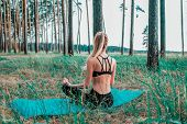 View From The Back, Girl Is Meditating In The Forest On A Yoga Mat. Healthy Lifestyle Fitness Outdoo poster