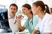 stock photo of trustworthiness  - Medical team checking on X - JPG