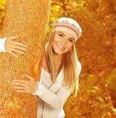 stock photo of beret  - Photo of cute happy girl in autumnal park - JPG