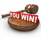 foto of payday  - The words You Win under a gavel to symbolize a legal victory in a court case or proceeding - JPG