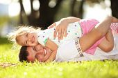 picture of cuddling  - father and daughter in the park - JPG