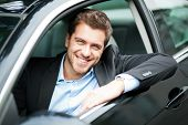 image of motor vehicles  - Handsome man in his new car - JPG