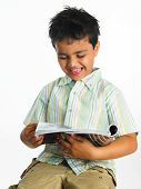 Asian Boy Reading A Book