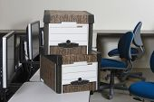 foto of box-end  - View of moving boxes by chairs on office desk - JPG