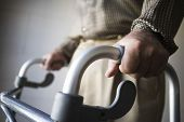 image of physically handicapped  - Closeup midsection of a man using walking frame - JPG