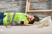 stock photo of workplace safety  - Construction worker in an accident - JPG