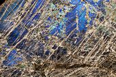 stock photo of feldspar  - Detail close up of the patterns and colours in the feldspar mineral Labradorite - JPG