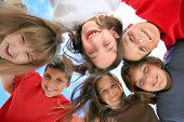 picture of katrina  - Happy Kids Huddling and Looking Down at the Viewer   - JPG