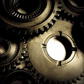 image of interlocking  - Closeup of metal cog gears - JPG
