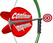 stock photo of persistence  - The words Continuous Improvement on an arrow airmed by a bow at a target to illustrate constant increase in quality - JPG