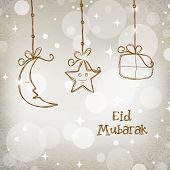 Muslim community festival Eid Mubarak concept with hanging moon, star and gift boxes on shiny grey b