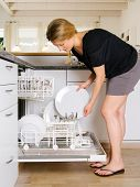 picture of bend over  - Photo of a blond female leaning over and unloading her dishwasher - JPG