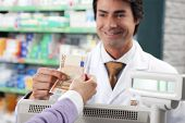 picture of cash register  - cropped view of woman shopping in pharmacy - JPG