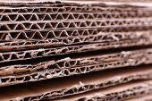 stock photo of reuse recycle  - Stack of cardboard for recycling close - JPG