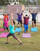 pic of boot camp  - Mature adult boot camp exercise group stretching outdoors - JPG