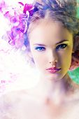 stock photo of smoking woman  - Beautiful girl with flowers in her hair - JPG