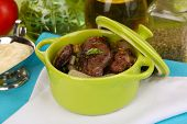 stock photo of liver fry  - Fried chicken livers in pan on wooden table close - JPG
