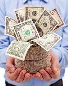 stock photo of sack dollar  - Incentive for businessman  - JPG