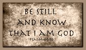 Be still and know that I am GOD. Encouraging bible scripture from Psalm 46:10 on a grunge stone back