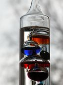 image of galileo-thermometer  - The Galileo thermometer creates a colorful and artistic image - JPG